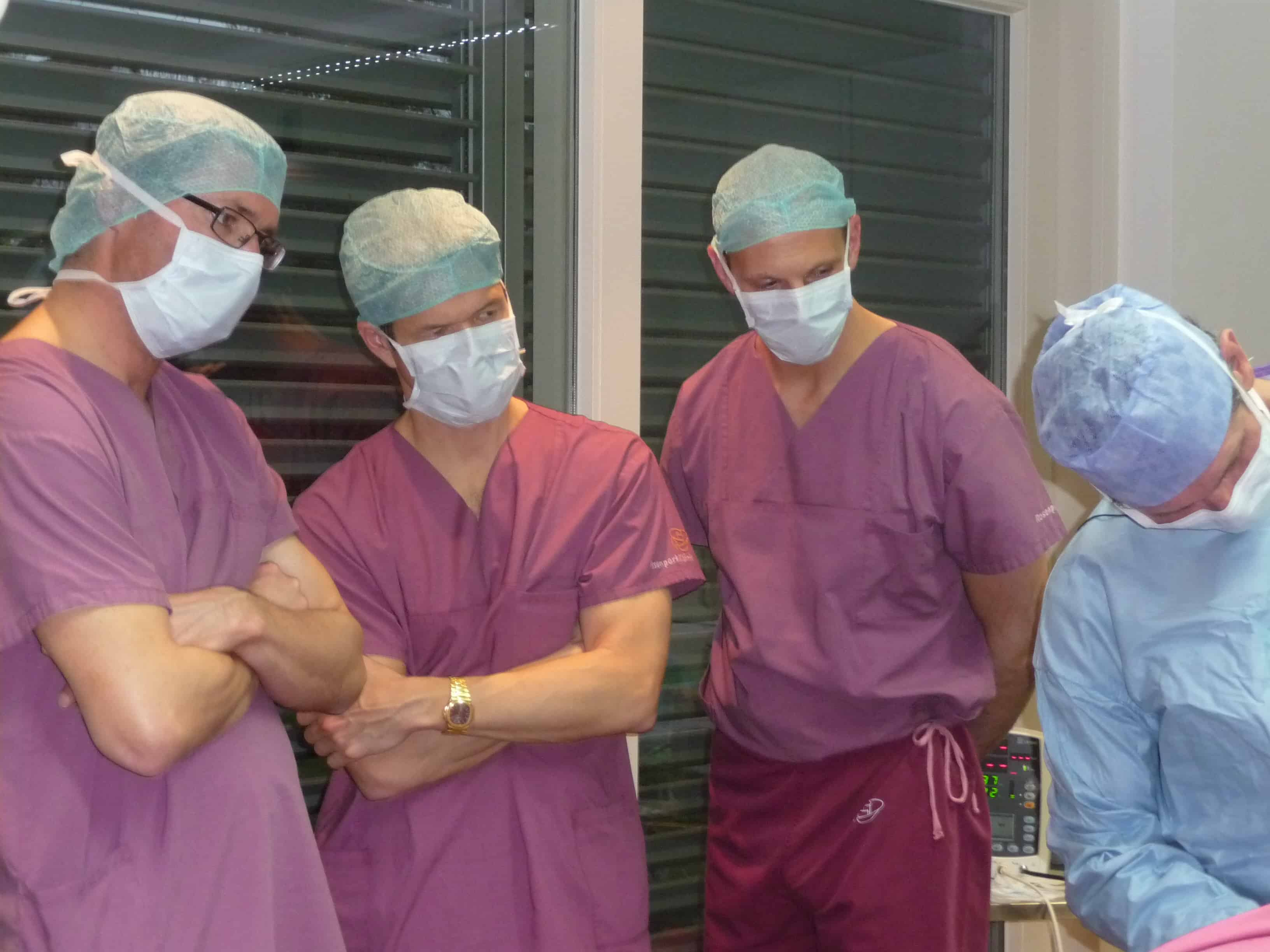 Dr. Stefan Rapprich, Dr. Mark Smith, Dr. Joe Dayan, observing surgery with Dr. Gerhard Sattler in Frankfurt Germany - March 2014